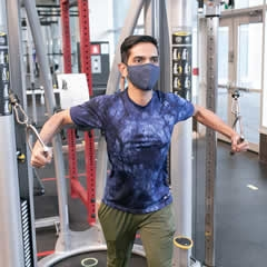 Man in the fitness centre wearing a mask