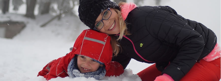Mother and child playing in the snow