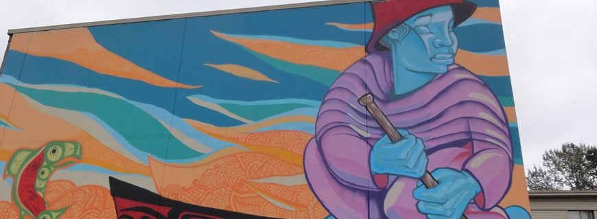 Public art mural on the side of a building