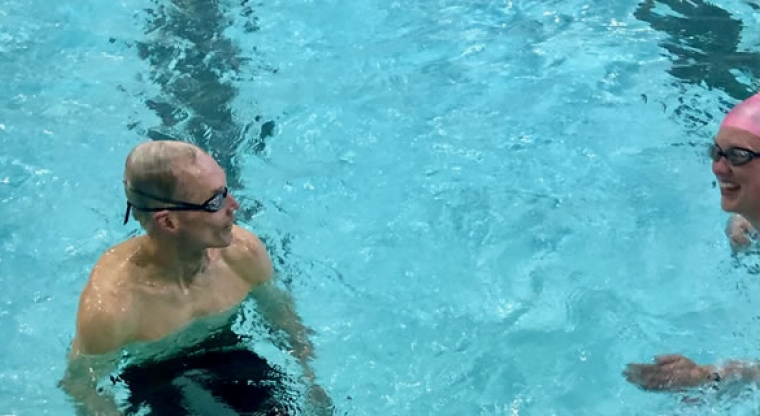 father and daughter lane swimming